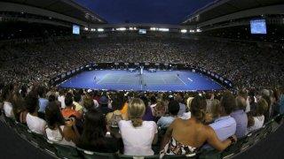 Espectadores durante un partido de tenis. REUTERS